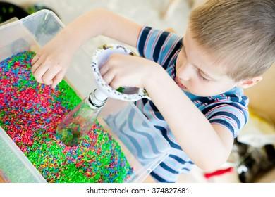 beautiful boy playing with Rice