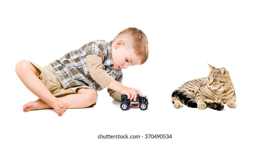 Beautiful boy playing toy car together with cat isolated on white background