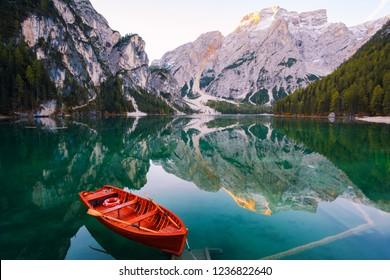 Beautiful Braies lake in boat and house in the background of Seekofel mountain in Dolomites,Italy ( Pragser Wildsee )
