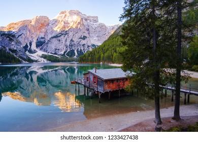 Beautiful Braies lake and house in the background of Seekofel mountain in Dolomites,Italy ( Pragser Wildsee )