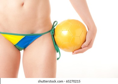 Beautiful Brazilian model wearing a green and yellow soccer thong bikini bottom  holding a soccer ball isolated over white background