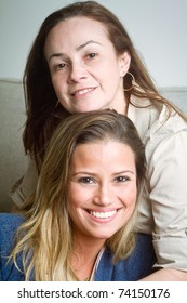 Beautiful Brazilian mother and daughter indoors portrait