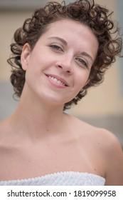 Beautiful Brazilian woman posing and looking at camera.