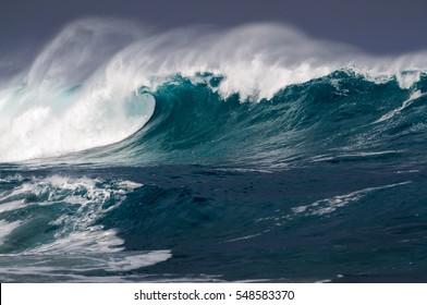 Beautiful breaking Ocean wave at Waimea bay on the north shore of Oahu Hawaii