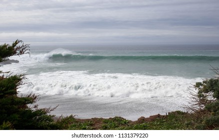 Beautiful breaking wave viewed from cliff at Gualala Point Regional Park in Northern California