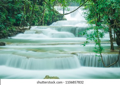 Beautiful and Breathtaking green waterfall at the tropical rain forest, Erawan's waterfall, Located Kanchanaburi Province, Thailand
