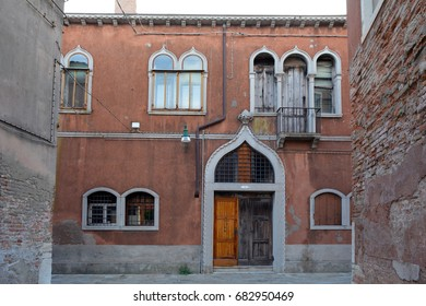 Beautiful brick building in Venice, Italy with arched decorative windows