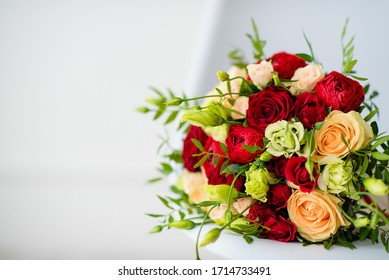 beautiful bridal bouquet of red roses, with red satin ribbons