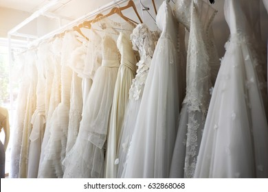 Beautiful bridal dress on hangers