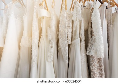 Beautiful bridal dress on hangers