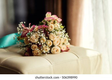 beautiful bridal wedding bouquet lying on the table