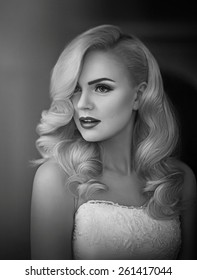 Beautiful bride blonde with stylish make-up in white dress