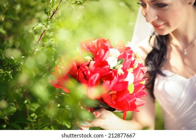 beautiful bride with a bouquet of tulips