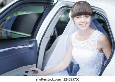 beautiful bride in the car