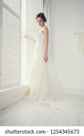 beautiful bride in classic white wedding dress