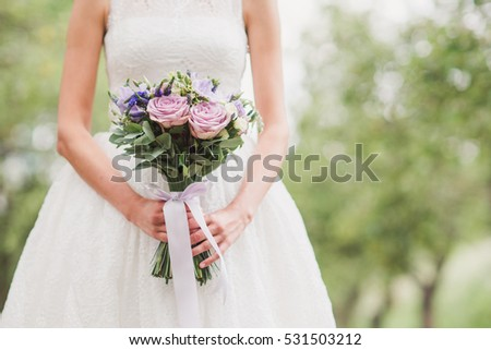 Beautiful bride closeup caucasian woman white stock photo edit now beautiful bride closeup caucasian woman in white wedding dress hold a bouquet of purple flowers mightylinksfo