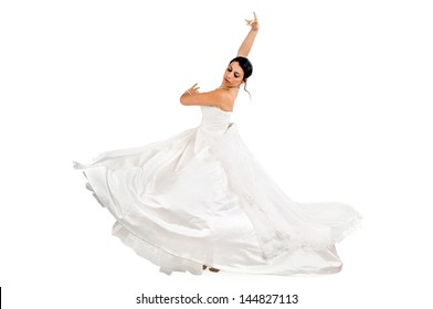 Beautiful bride dancing isolated in white