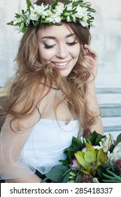 Beautiful Bride in decor, girl with flowers