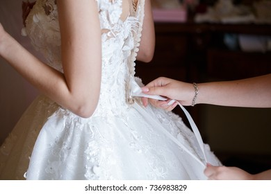 beautiful bride dress decorated with beads and lace