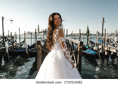 beautiful bride dressed in a wedding dress and stands near the pier,fashionable wedding dress,smiling bride in dress,