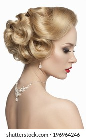 Beautiful bride with fashion wedding hairstyle  on white background  Vintage image of a bride with red lips and a wedding hairdo.