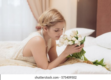 Beautiful bride and flower bouquet in hotel room. Bridal concept.