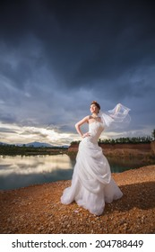 beautiful bride in forest,cloudy twilight blue sky