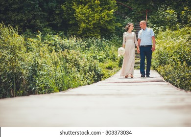 Beautiful bride and groom by a lake