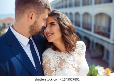 Beautiful Bride and Groom enjoy each other. happy romantic young couple celebrating their marriage. Sexy kissing stylish couple of lovers close up portrait. wedding concept