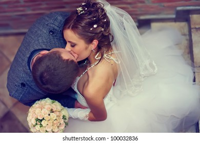 beautiful  bride and groom kissing. top view