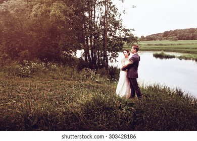 Beautiful bride and groom outdoors in the woods.