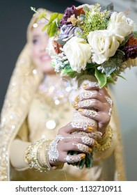 Beautiful Bride Hands with Henna holding blooms, Indonesian Wedding Tradition Ceremony
