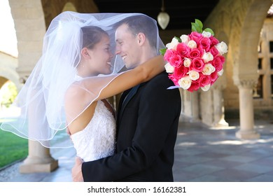 A beautiful bride and handsome groom at church during wedding