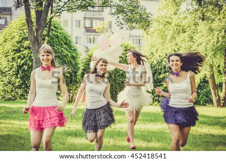 beautiful bride and happy bridesmaids celebrating hen partyhappy young hipster girls having fun