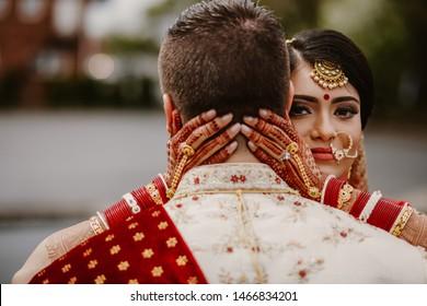 A beautiful bride Hindu hugs her husband on the wedding day