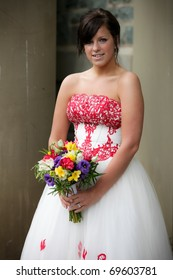 Beautiful bride holding flowers