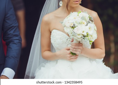 beautiful bride holding wedding bouquet