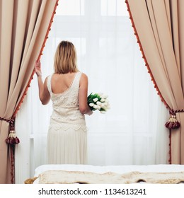 Beautiful bride in hotel room
