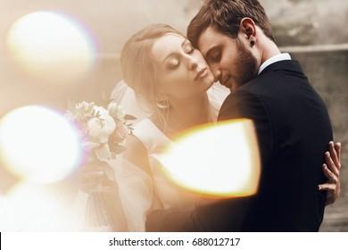 Beautiful bride leans to groom tender