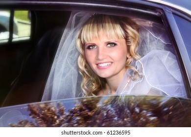 Beautiful bride in limousine