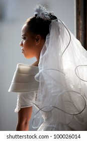 Beautiful Bride lit up from light showering her from the open window