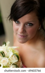 Beautiful bride looking up to the camera