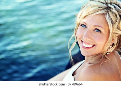 Beautiful Bride looking at camera with water as background