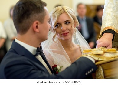 beautiful bride looks at her fiance on wedding ceremony