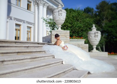 Beautiful bride lying on the stairs