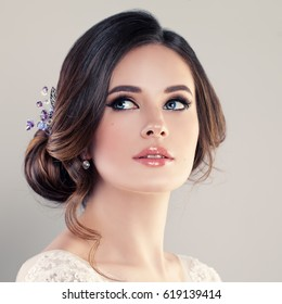 Beautiful Bride with  Makeup and Bridal Hairstyle. Pretty Woman Fiancee Looking Up, Face Closeup