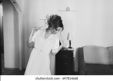 The beautiful bride in the morning dresses for a wedding ceremony