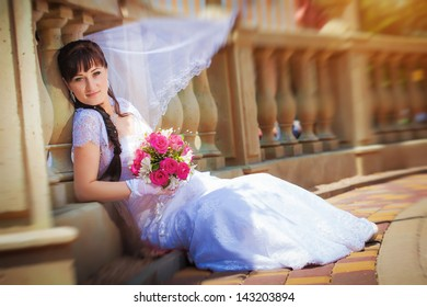 beautiful bride near ancient columns