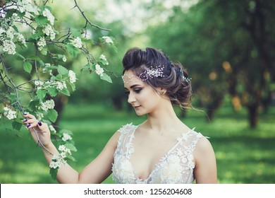 Beautiful bride outdoors in a blossom park