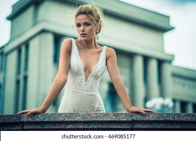 Beautiful bride outdoors on a street.